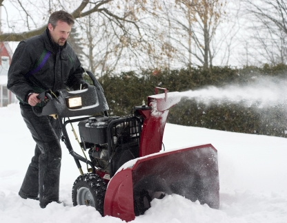 Man Operating Snow Blower